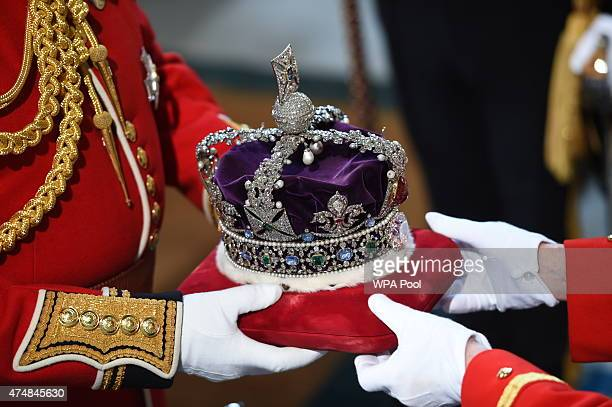 The Imperial State Crown is carried during the State Opening of Parliament in the House of Lords at the Palace of Westminster on May 27 2015 in...