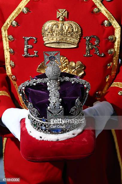 The Imperial State Crown is carried for the State Opening of Parliament at the Houses of Parliament on May 27 2015 in London England The Queen's...