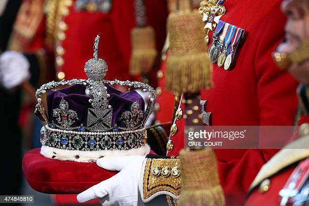 The Imperial State Crown is carried for the State Opening of Parliament at the Palace of Westminster in central London on May 27 2015 The State...
