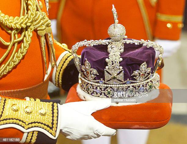 The Imperial State Crown is carried into Parliament through the Sovereigns Entrance of the Palace of Westminster for the Queen to wear during the...