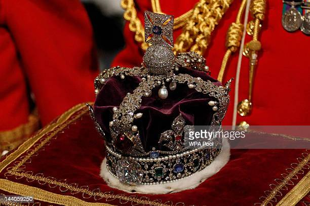 The Imperial State Crown is carried through the Norman Porch of the Palace of Westminster during the State Opening of Parliament on May 09 2012 in...