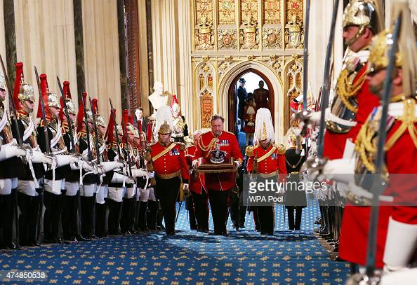 The Imperial State Crown is carried through the Norman Porch of the House of Commons prior to the State Opening of Parliament in the House of Lords...