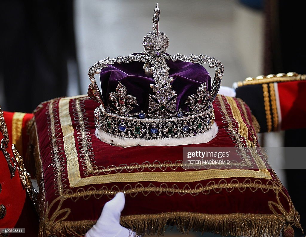 The Imperial State Crown, worn by Britain's Queen Elizabeth II, is taken from Parliament during the State Opening of Parliament at the Houses of Parliament, in central London on May 25, 2010. Britain's Queen Elizabeth II set out the new coalition government's legislative programme on Tuesday in a ceremony of pomp and history following the closest general election for decades. AFP PHOTO/Peter Macdiarmid/Pool