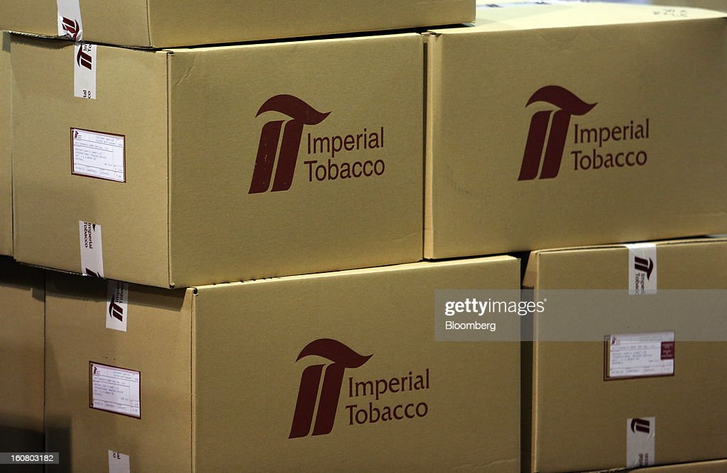 The Imperial Tobacco Group Plc logo sits on boxes filled with cigarettes ahead of distribution at the company's factory in Nottingham, U.K., on Friday, Feb. 1, 2013. Imperial Tobacco Group Plc is Europe's second-biggest tobacco company and generates about 40 percent of its profit from the region. Photographer: Chris Ratcliffe/Bloomberg via Getty Images