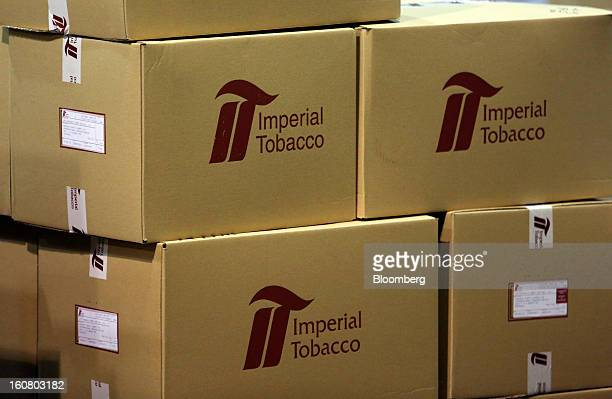 The Imperial Tobacco Group Plc logo sits on boxes filled with cigarettes ahead of distribution at the company's factory in Nottingham UK on Friday...