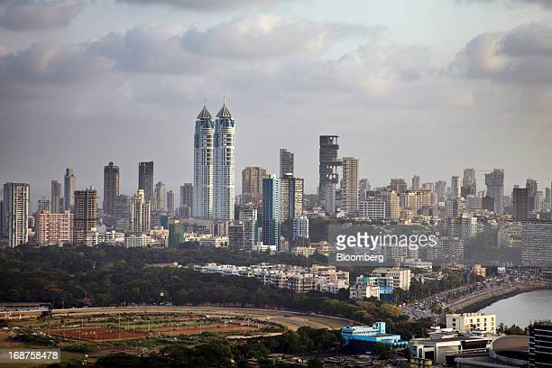 The Imperial twin towers center left stand among other buildings as seen from the Aer rooftop bar at the Four Seasons Hotel in the Worli area of...