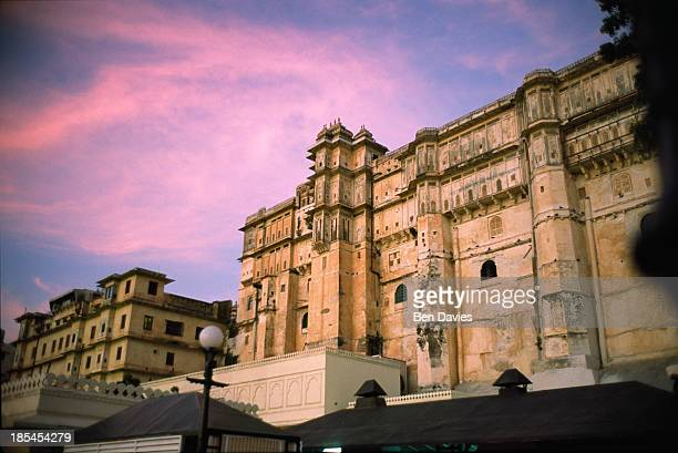 The imposing facade of Udaipur City Palace viewed across Lake Pichola in the elegant waterfront district of Udaipur in Rajastaan This magical city...