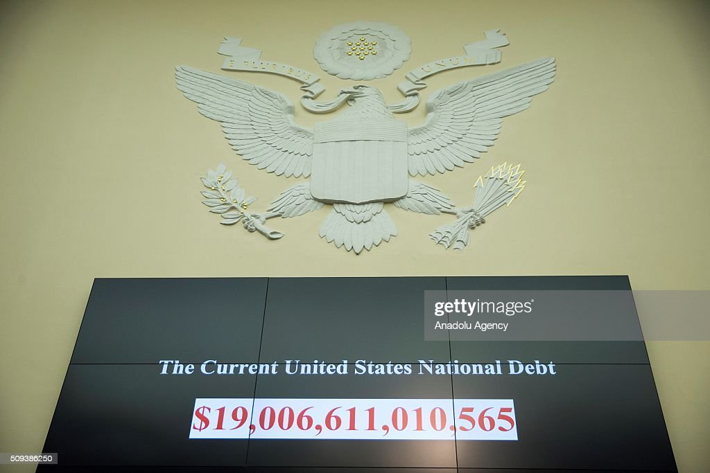 The increasing United States National Debt is projected on screens during a House Financial Services Committee hearing on monetary policy and the state of the economy in Washington, USA on February 9, 2016.