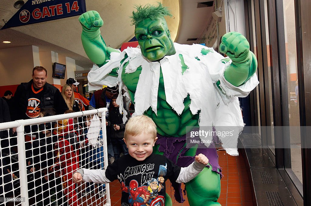 The Incredible Hulk poses with fans for Superhero Celebration day prior to the game between the New York Islanders and the Tampa Bay Lightning at Nassau Veterans Memorial Coliseum on January 21, 2013 in Uniondale, New York.