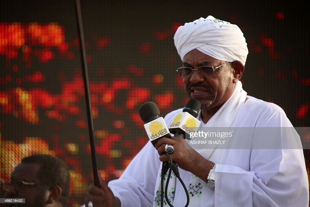 The incumbent president and candidate of the ruling National Congress Party (NCP) for Sudans presidency <a gi-track='captionPersonalityLinkClicked' href=/galleries/search?phrase=Omar+al-Bashir&family=editorial&specificpeople=588924 ng-click='$event.stopPropagation()'>Omar al-Bashir</a> gives a speech on March 31, 2015 in the capital Khartoum, during a campaign meeting ahead of the April 13 parliamentary and presidential elections. The National Electoral Commission has said some 14 candidates are competing with Bashir for the presidency but most are little-known and pose no real threat to his reelection bid. AFP PHOTO / ASHRAF SHAZLY