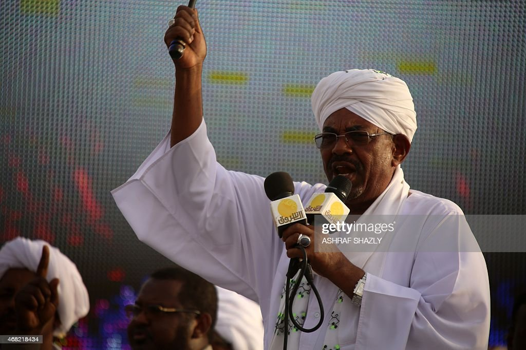 The incumbent president and candidate of the ruling National Congress Party (NCP) for Sudans presidency Omar al-Bashir gives a speech on March 31, 2015 in the capital Khartoum, during a campaign meeting ahead of the April 13 parliamentary and presidential elections. The National Electoral Commission has said some 14 candidates are competing with Bashir for the presidency but most are little-known and pose no real threat to his reelection bid. AFP PHOTO / ASHRAF SHAZLY