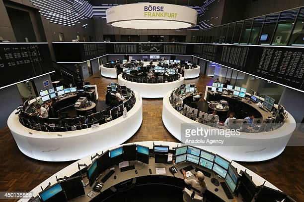The index board shows that the DAX has broken the 10000 mark for the first time ever at the Deutsche Boerse exchange after European Central Bank...