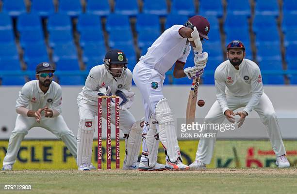 The India cricket team members stand ready as West Indies cricketer Devendra Bishoo bats during day three of the cricket test match between West...