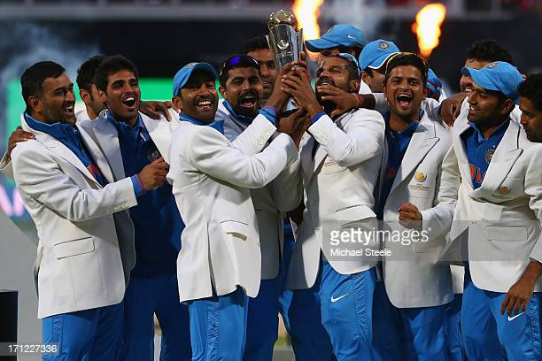 The India squad lift the winners trophy as they celebrate their 5 run victory during the ICC Champions Trophy Final match between England and India...