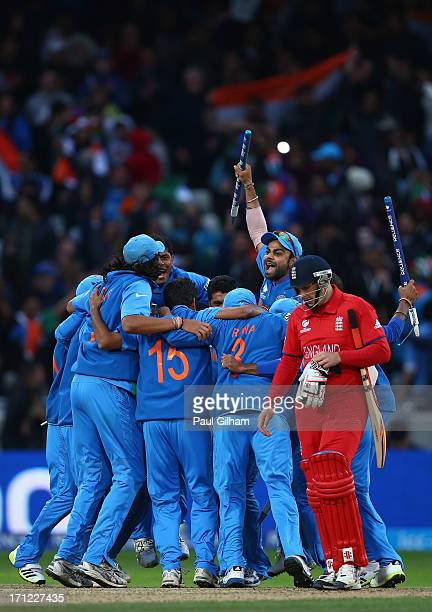 The India team celebrate as James Tredwell of England looks dejected after India won the ICC Champions Trophy Final match between England and India...