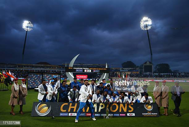 The India team celebrate winning The ICC Champions Trophy as Virat Kohli of India dances at the front of the celebrations after India beat England in...