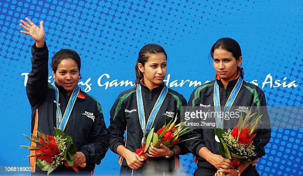 The India team celebrate with the silver medals won in the Women's 10m Air Pistol Team competition at the Aoti Shooting Range during day two of the...
