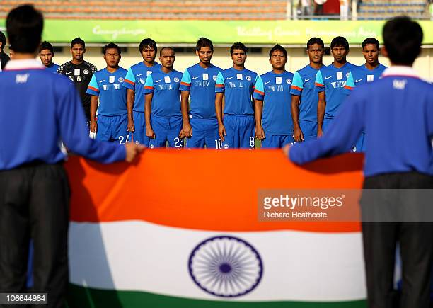 The India team sing their national anthem prior to kickoff during the Men's Football group D pool match between Qatar and India ahead of the 16th...