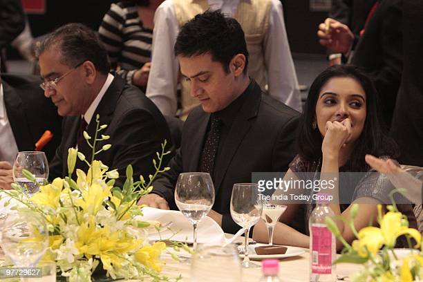 The India Today Group Chairman Aroon Purie with actors Aamir Khan and Asin Thottumkal at the Gala Dinner of the India Today Conclave in Delhi on...