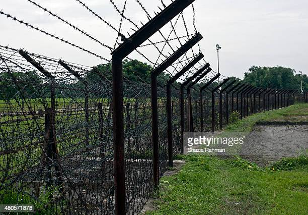 The India/Bangladesh border fence is seen July 10 2015 in Lalmonirhat District Bangladesh The India Bangladesh enclaves also known as the chitmahals...