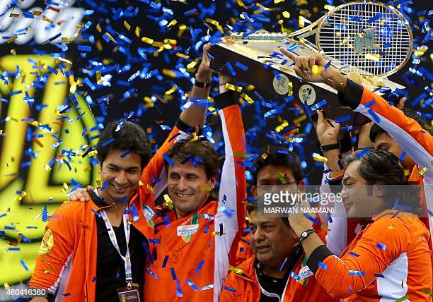 The Indian Aces team celebrates with its trophy after winning the CocaCola International Premier Tennis League tournament at the Hamdan Sports...