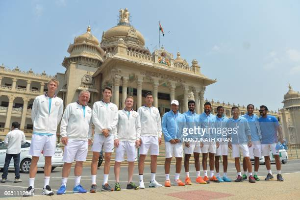 The Indian and Uzbek Davis Cup tennis team members pose for a photograph in front of the Vidhana Soudha building where the draw for the forthcoming...