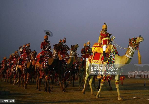 The Indian Border Security Force band ride on camels during the BSF Tattoo in New Delhi 17 November 2007 The word 'tattoo' originally dates from the...