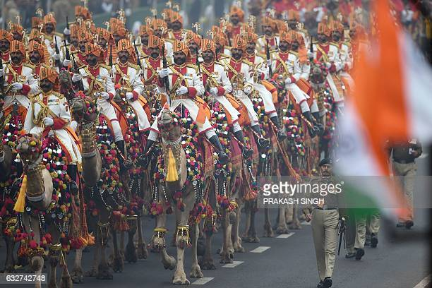 The Indian Border Security Force camel contingent marches past during the Republic Day Parade at rajpath in New Delhi on January 26 2017 Motorbike...