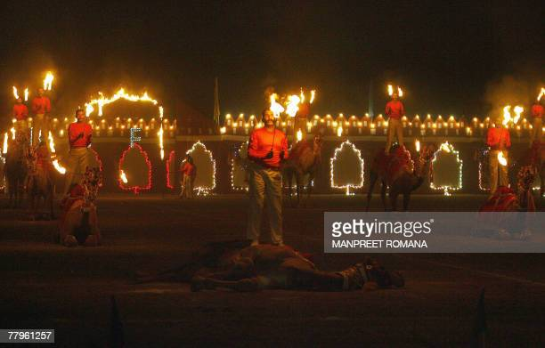 The Indian Border Security Force soldiers perform on camels during the BSF Tattoo in New Delhi 17 November 2007 The word 'tattoo' originally dates...