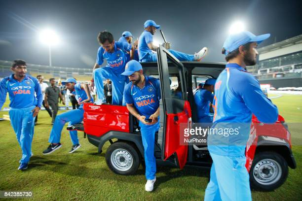 The Indian cricket captain Virat Kohli and team mates take a ride in a van after winning the ODI series against the host Sri Lanka by 50 after the...