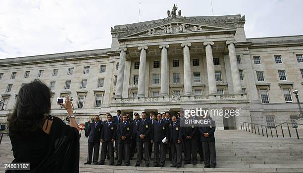 The Indian cricket team pose 22 June 2007 in front of Stormont Paraliment building in Belfast Northern Ireland India South Africa and Ireland will...