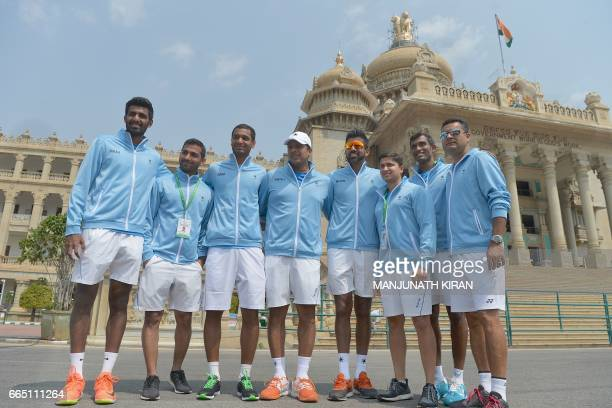 The Indian Davis Cup tennis team poses for a photograph in front of the Vidhana Soudha building where the draw for the forthcoming Asia Oceania group...
