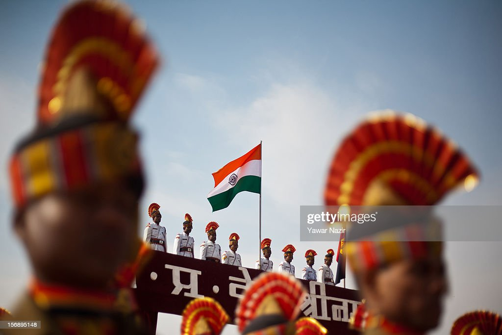 The Indian flag flies above Indian Border Security Force (BSF) soldiers standing in formation during their passing out parade on November 24, 2012 in Humhama, on the outskirts of Srinagar, the summer capital of Indian administered Kashmir, India. 545 new trained recruits of the Indian paramilitary Border Security Force constables took oaths during their passing out parade after successfully completing 36 weeks of basic training which involved physical fitness, weapons handling, map reading, counter-insurgency operations and human rights. The recruits will join Indian soldiers to fight militants in Kashmir, a spokesman of the paramilitary BSF said. India has already close to a million soldiers posted in Jammu and Kashmir, making the disputed Himalayan region one of the most militarized zone in the world