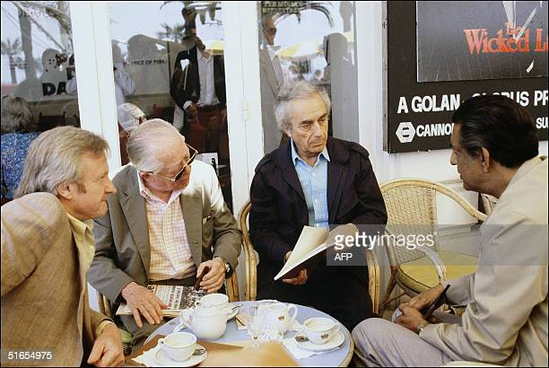 The Indian movie director Satyajit Ray chats with Borman Wilder and Antonioni during the Cannes Festival May 1982 His first film was 'On the Road'...