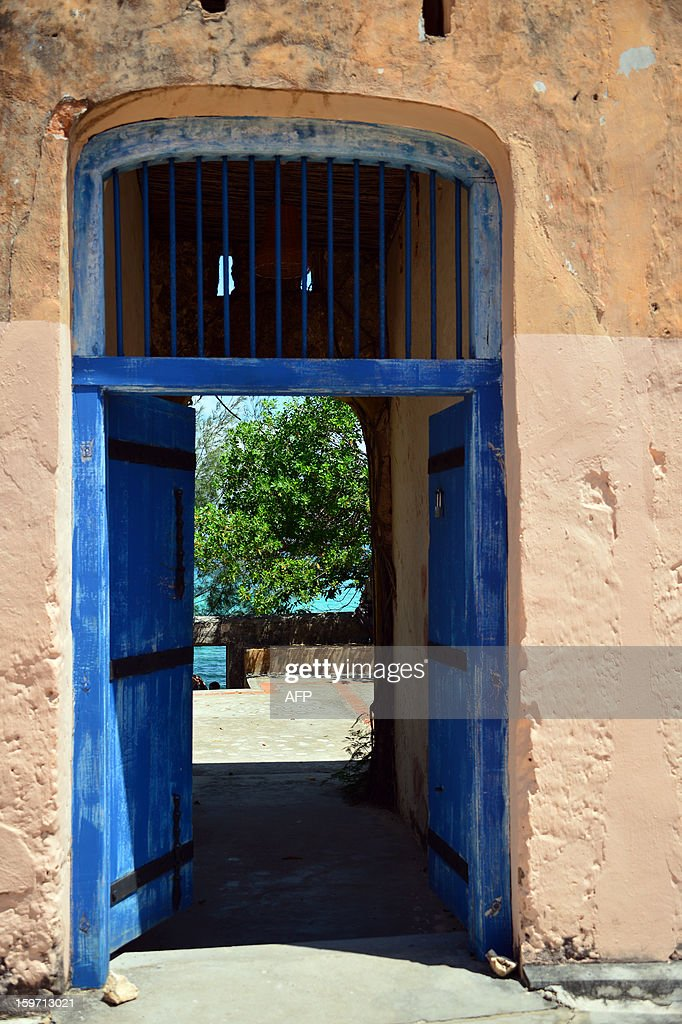 The Indian ocean is seen through the gate of a house on January 9, 2013 in Zanzibar.