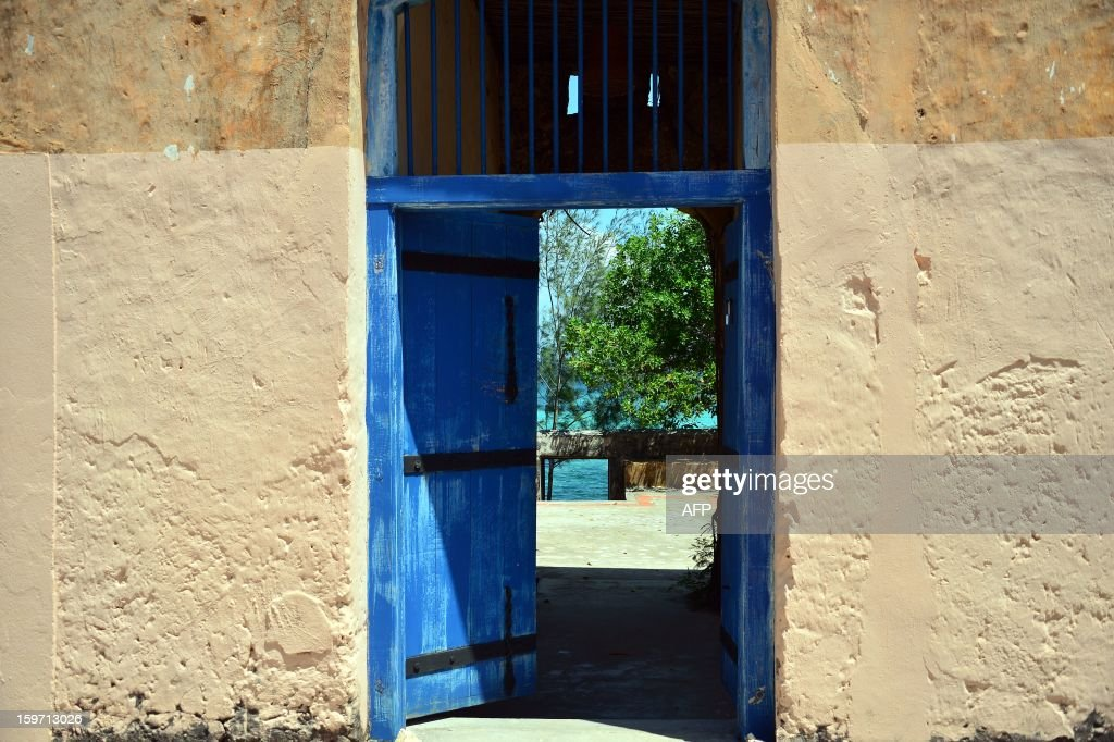 The Indian ocean is seen through the gate of a house on January 9, 2013 in Zanzibar. AFP PHOTO / GABRIEL BOUYS