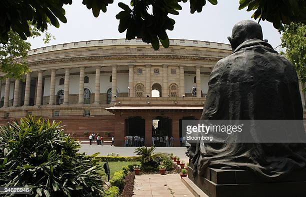 The Indian Parliament building stands in New Delhi India on Thursday April 26 2007 Indian Prime Minister Manmohan Singh's ruling coalition will try...