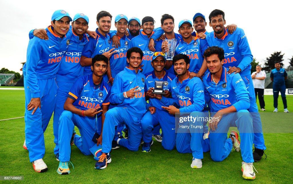 The Indian playing squad pose with the trophy during the 5th Youth ODI match between England U19s and India Under 19s at The Cooper Associates County Ground on August 16, 2017 in Taunton, England.