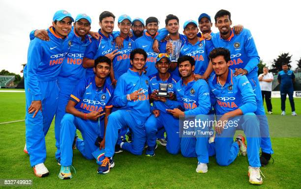 The Indian playing squad pose with the trophy during the 5th Youth ODI match between England U19s and India Under 19s at The Cooper Associates County...