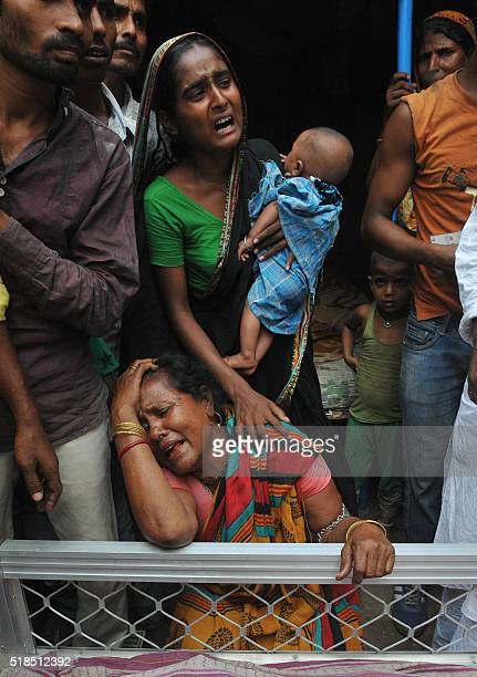 The Indian relatives of a man killed in a flyover bridge collapse mourn next to his body a day after the disaster in Kolkata on April 1 2016...