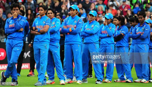 The Indian side cut dejected figures at the end during the ICC Women's World Cup 2017 Final between England and India at Lord's Cricket Ground on...