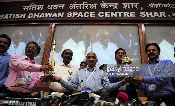 The Indian Space Research Organisation chairman AS Kiran Kumar Rao along with his team holds a model of satellite INSAT3DR and Geosynchronous...