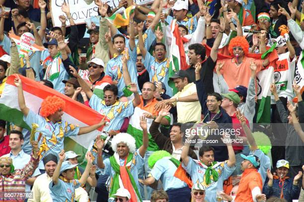 The Indian supporters celebrate the first 'six' of the day against New Zealand