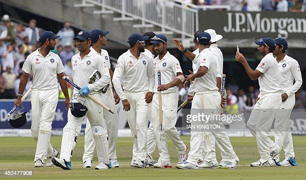 The Indian team celebrate after winning the match by 95 runs on the fifth day of the second cricket Test match between England and India at Lord's...
