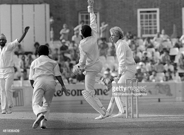 The Indian team celebrate as England batsman David Gower is out caught by the wicketkeeper Bharath Reddy off the bowling of Bishan Singh Bedi during...