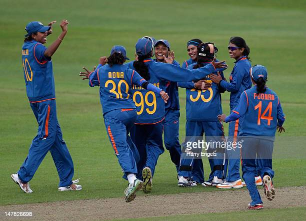The Indian team celebrate taking a wicket during the 2nd NatWest International One Day match between England Women and India Women at The County...