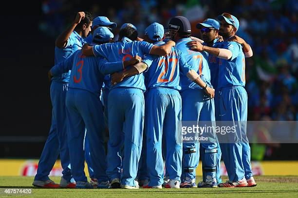 The Indian team celebrate taking the wicket of Glenn Maxwell of Australia during the 2015 Cricket World Cup Semi Final match between Australia and...