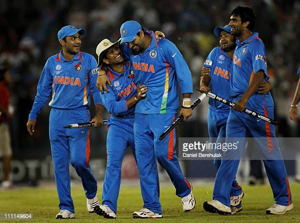 The Indian team celebrate victory over Pakistan during the 2011 ICC World Cup second SemiFinal between India and Pakistan at Punjab Cricket...