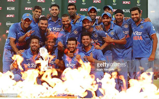The Indian team celebrate with the series trophy after victory in the International Twenty20 match between Australia and India at Sydney Cricket...