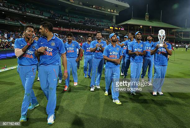 The Indian team do a victory lap after the third Twenty20 international cricket match between India and Australia in Sydney on January 31 2016 GOLDING